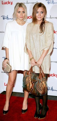 Mary-Kate and Ashley Olsen in white and tan dresses and black heels