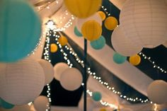 Use bright colours to liven up the plain backdrop and add an element of fun! Hang the lights and lanterns in the shape of the canopy to make use of the high ceiling.