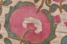 detail of an antique  suzani fragment, Uzbekistan, silk on linen, XIXth century, circa cm 84X36 ref 5236