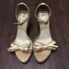 Nude Dior Wedges Good condition nude wedges. Basket weave wedge. 3 1/2 inch heel. Bow strap. 100% authentic. Same day or next day shipping. No trades no holds. 20% off of bundles. Dior Shoes Wedges
