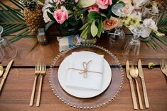 To match the tropical flowers, we used gold cutlery and glass chargers.  Napkins are tied with rope Gold Cutlery, Tropical Flowers, Unique Weddings, Wedding Reception, Florals, Napkins, Table Decorations, Glass, Gold Flatware