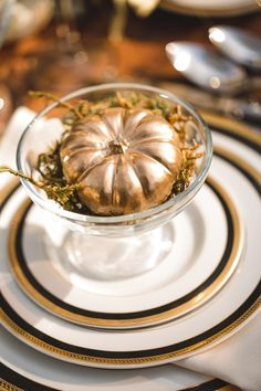 Gold and Black Pumpkin Table Setting for a Halloween Inspired wedding