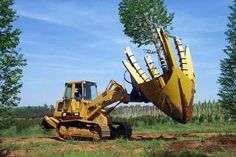 , Nasser Heavy Equipment recently installed tree spades on two different machines . , Nasser Heavy Equipment recently installed tree spades on two different machines that Bold Spring Nursery in Monroe, GA, was purchasing from the Lawren. Heavy Construction Equipment, Heavy Equipment, Construction Machines, Earth Moving Equipment, Heavy Machinery, Industrial Machinery, Logging Equipment, Backhoe Loader, Engin