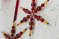 Wine red beaded snowflakes are traditional Christmas decor. Set of 2 burgundy and gold snowflake ornaments make great winter holiday gift! Made of wine red glass beads and golden metal beads. Diameter of each snowflake is 3.1-3.3 inches (8-8.5 cm). See other gorgeous beaded snowflakes