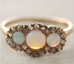 I would die to have this ring. sooo beautiful--opals