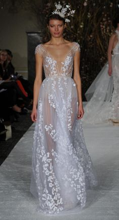 Sheer gown with plunging neckline and cap sleeves | Mira Zwillinger Spring 2017 | https://www.theknot.com/content/mira-zwillinger-wedding-dresses-bridal-fashion-week-spring-2017