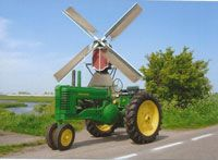 My 1950 late styled model A John Deere tractor in front of a MOVING Dutch windmill.