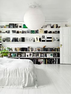 That's my bookshelves. I want my bedroom to have a bookshelf like that. It is super simple, beautiful and elegant. So why not.
