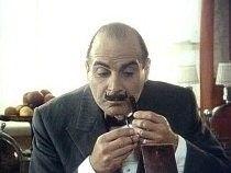 Hercule Poirot caring for the famous moustache.