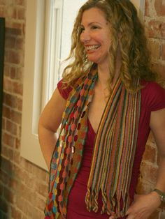 Sophie Digard Ecouter Summer Scarf  a sea of multi-colored parallel stripes, balanced by an open honeycomb pattern with airy windows on the other half—both hand-crocheted in a vibrant summer palette of turquoise, pink, mustard, red, teal, toast, orange, and plum! ... love the way the stripes separate and twist into fringe at the end!!!