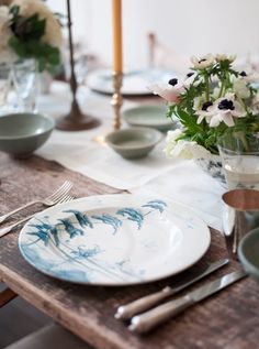 Easter lunch tablescape with Gwyneth Paltrow. palette of white, pale pink, lilac, robin's egg blue, and a bit of black on a rustic, antique table.