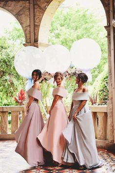 Classy and stylish pastel bridesmaid gowns from The Doll House Bridesmaids!