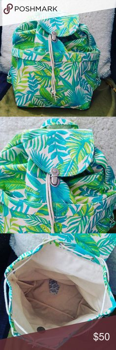 Jungle Leaves Backpack Cotton canvas drawstring backpack in blue, green, yellow and cream leafy motif. Very sturdy with two front zipper pockets and a metal clasp on flap. Also, super roomy inside! Baggu Bags Backpacks