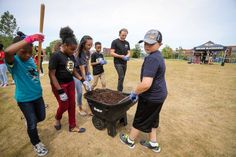 Patrick Kane works with students to plant trees as part of the NHL Green Legacy Tree Project.