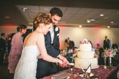 A lovely May wedding cutting the cake. The Willinghams Photography. Weddings at Curtis Ballroom at The Landmark, Greenwood Village, Colorado.