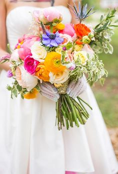 Bouquet of ranunculuses, anemones, thistles, mini pittosporum, garden roses, veronica, peonies, and bunny tail grasses, $275, Hey Gorgeous Events