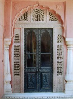 This is a beautiful entry somewhere in India, but the soft pink surround with black door is a concept we can borrow ...