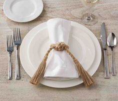 Jute rope tied into a knot to create a napkin ring and then tasseled for an elegant nautical look for the table.