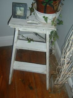 White step ladder.  Would look nice next to french doors with a pot plant. and black board above.