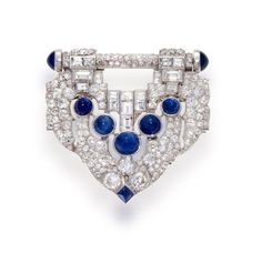 An art deco sapphire and diamond clip-brooch, J.E. Caldwell, circa 1925  the shield-shaped panel set throughout with old European-cut diamonds and further accentuated by baguette-cut diamonds and sugar loaf sapphires; signed JEC & Co., estimated total diamond weight: 9.00 carats; mounted in platinum; length: 1 3/4in. by wteresa