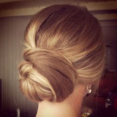 Sleek and Simple by: The Wedding Hair at: http://hairaddiction.collectivepress.com/22-elegant-wedding-hairstyles-that-have-us-saying-i-do/