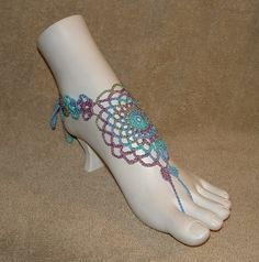 WE CAN HAVE SOMETHING ON OUR FEET LIKE THIS AND THEN HAVE FLIP FLIP FLOPS AS WELL....LIKE FOOT JEWELRY