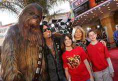 Musician Nikki Sixx (second from left) and family pose with the character Chewbacca as they arrive at the 'Star Wars Episode III - Revenge Of The Sith' Los Angeles Premiere at the Mann Village Theatre on May 12, 2005 in Westwood, California. The premiere benefits the charity Artists for a New South Africa and its compreshensive, ground-breaking program for South African children orphaned by HIV/AIDS.