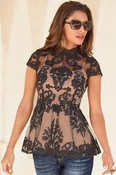 Seductive lace overlay top in a figure-flattering silhouette. Exposed back zip. Attached camisole. Bra friendly.
