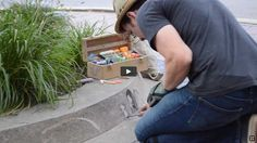 """VIDEO ABOUT . . . David Zinn as he creates one of his popular chalk art drawings """"The Secret Admirer,"""" on the street in Dexter, Michigan. (interview, August 25, 2014)"""