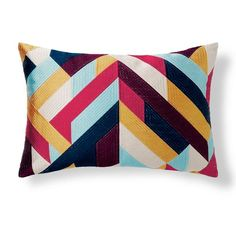Reds, blues, orange, and purple find their way onto the Bold Mariposa Pillow in a geometric pattern that has a one-of-a-kind look, because the strips of    color are stitched onto the pillow with embroidery. This updated style is feather-filled for a soft, comfortable feeling that looks wonderful plumped and    staged on a sofa or bed. The cotton