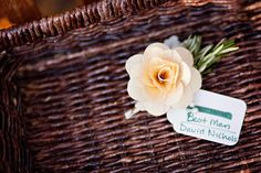 Groomsmen wore these sweet wooden flowers as boutonnieres. Photography by kmifoto.com via stylemepretty.com