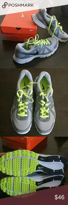 NIB NIKE SNEAKERS NIB never worn Revolution 2 Gray and black with yellow neon laces Smoke free home Comes in original box Nike Shoes Sneakers
