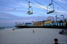 #thejerseyshore #boardwalk #familyfun SEASIDE HEIGHTS, NJ - JULY 15: A view of Casino Pier on July 15, 2003 in Seaside Heights, New Jersey where visitors come to soak in the sun, ride the Ferris wheel, eat saltwater taffy and stroll the boardwalk on a hot summer night. The Jersey Shore, a 127 mile stretch of coastline known for its variety of beaches, boardwalks, small towns, natural beauty and summer crowds, has been a popular summer destination for over a century. (Photo By Amy Toensing)