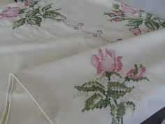 Pineapple House Antiques ~ A pink and green cross-stitch floral tablecloth!