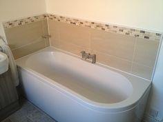 Stone Mosaics w/ Large Format Porcelain Tiles as Bath Backsplash by UK Bathroom Guru