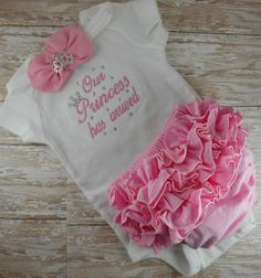 Our Princess has arrived embroidered baby girl newborn set. This set includes a custom embroidered infant bodysuit, ruffle bloomer, and matching