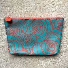 """Rose patterned makeup/cosmetic bag Makeup/cosmetics bag measuring 5 x 7.5"""". Very cute blue and coral rose pattern! Never used. NWOT. Ipsy Bags Cosmetic Bags & Cases"""