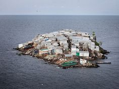 Migingo is a tiny rock island, about half the size of a football field, located in Lake Victoria, the largest lake in Africa and the largest tropical lake in the world. Although tiny in size, the island is home to 131 people (according to 2009 census) living in crammed huts made of corrugated sheets and wood. Despite shabby living conditions, Migingo Island boasts of five bars, a beauty salon, a pharmacy as well as several hotels and numerous brothels.