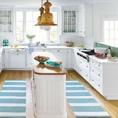 narrow-simple-kitchen-island-with-white-cabinets-and-striped-carpets-ideas