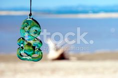 Typical Maori Tiki with Sea Background royalty-free stock photo Image Now, New Zealand, Royalty Free Stock Photos, Sea, Photography, Maori, Photograph, Fotografie, The Ocean
