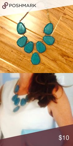 Chunky teal statement necklace. It's a deep turquoise/teal. It has a bit of crackle design too it. I thought it looked lovely against white. Will be perfect for spring! Jewelry Necklaces
