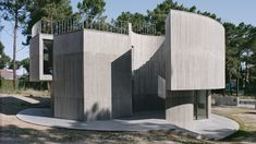 Double O Studio has designed Trefoil House in Aroeira, Portugal, as a series of overlapping concrete shapes topped by a long swimming pool.