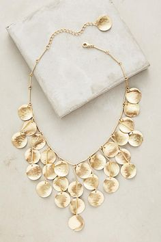 """A pretty way to provide """"protection"""" to the jugular.  Sun Shower Necklace - anthropologie.com"""
