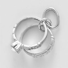 Wedding Rings Charm $22.50 http://www.charmnjewelry.com/category/sterling_silver-Love_and_Marriage_Charms.htm #WeddingCharm  #SilverCharm  #CharmnJewelry