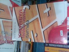 Buku Evaluasi Pembelajaran Matematika. Pengarang Drs. Ali Hamzah, M.Pd.