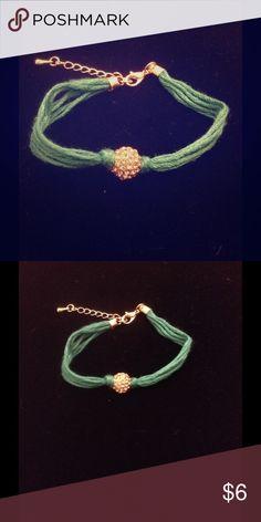 Green thread charm bracelet Green and gold charm bracelet. Great to wear all day Jewelry Bracelets