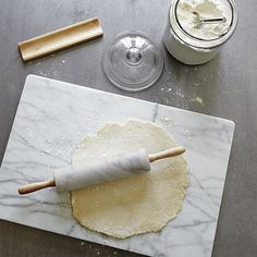 Beautiful, cool white marble rolling pin has the smoothness and heft to handle even the toughest dough. Display-worthy rolling pin nests in a rubberwood stand that matches the ergonomic handles. Each pin will differ due to the natural characteristics of the marble.