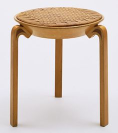 "Stool (no. V63)  Alvar Aalto (Finnish, 1898–1976)    1946-47. Solid and laminated wood and rattan, 17 3/4 x 17 1/2"" (45.1 x 44.5 cm). Manufactured by Oy Huonekalu-ja Rakennustyötehdas Ab, Turku, Finland. Marshall Cogan Purchase Fund"