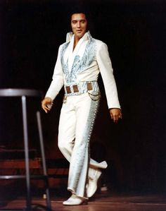 "Milwaukee,Wisconsin June 28th 1974 . Elvis is wearing the "" Aqua Blue Phoenix "" with its original belt. It was probably worn for the first time at the May 13th 1974 show in San Bernadino, CA but with an "" alternative belt "". This jumpsuit has never been used after 1974."