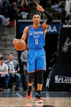 Russell Westbrook brings the ball up court in a playoff game at San Antonio.